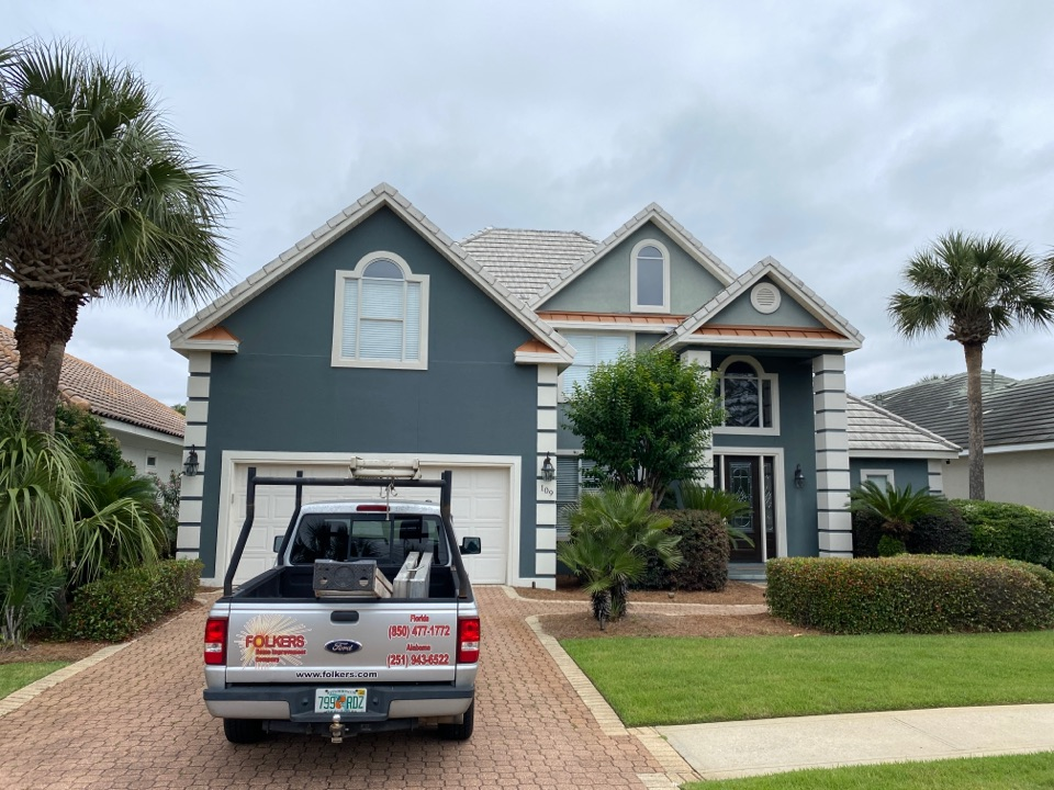 Measuring for impact replacement Viwinco single hung windows, fixed picture windows and impact thermatru replacement entry doors in Destin Florida