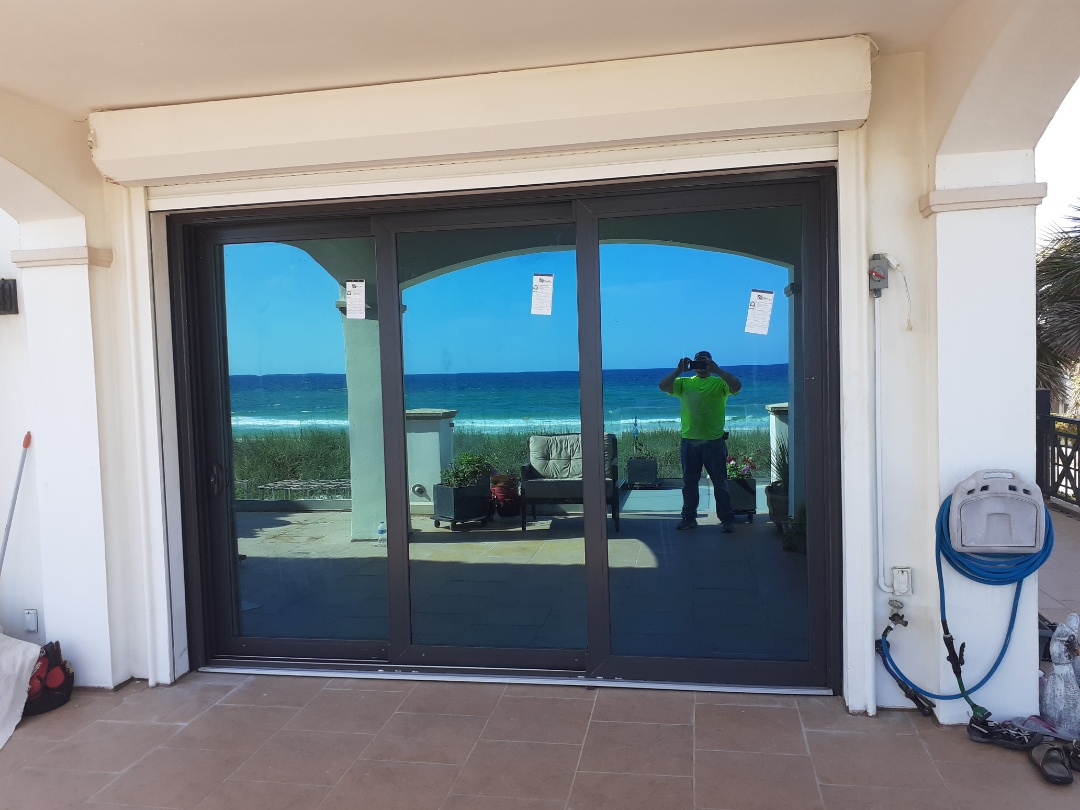 Pensacola Beach, FL - 4- 3 panel custom sliding glass doors and 1 shwinco french door.