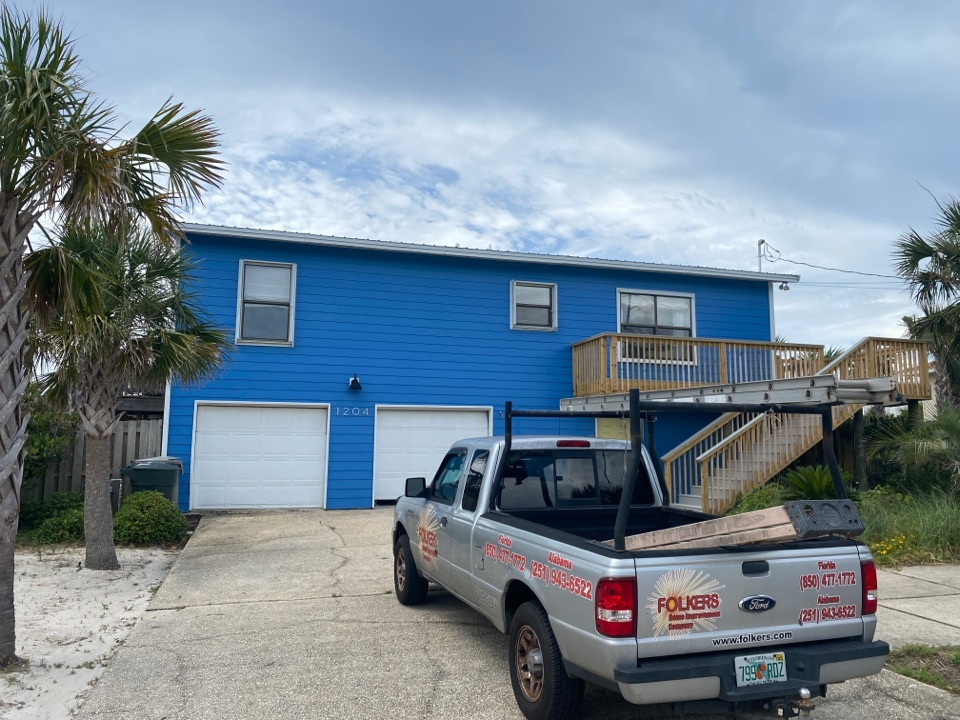 Pensacola Beach, FL - Measuring for impact replacement  Viwinco single hung windows, fixed picture windows and sliding windows on Pensacola beach Florida