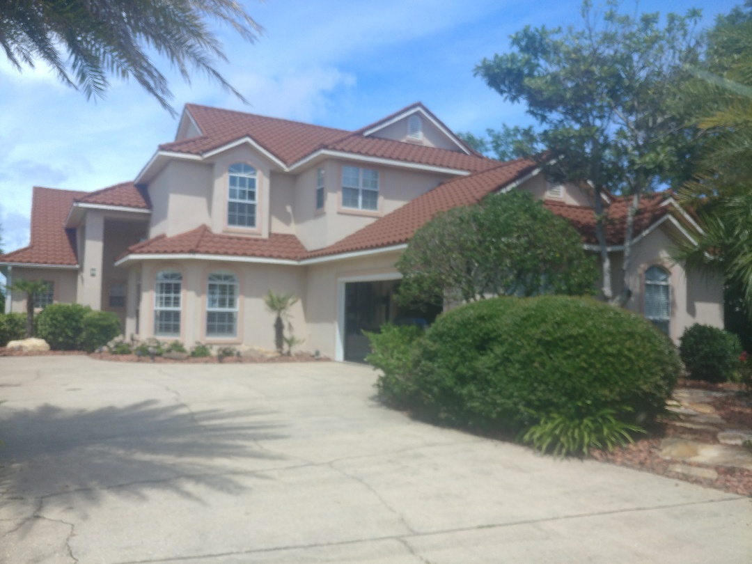 Gulf Breeze, FL - Shutters for the ground floor, impact windows up high