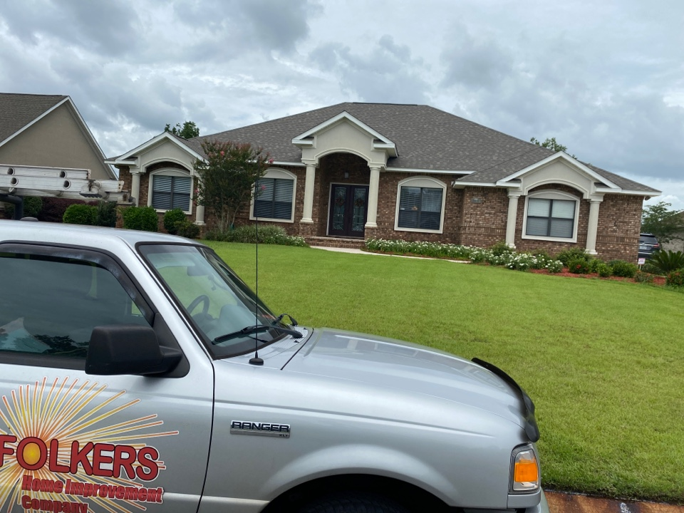 Milton, FL - Measuring for impact replacement CWS windows in Milton Florida