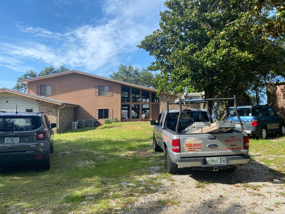Navarre, FL - Measuring for impact replacement Viwinco windows and impact thermatru replacement entry doors in Navarre Florida