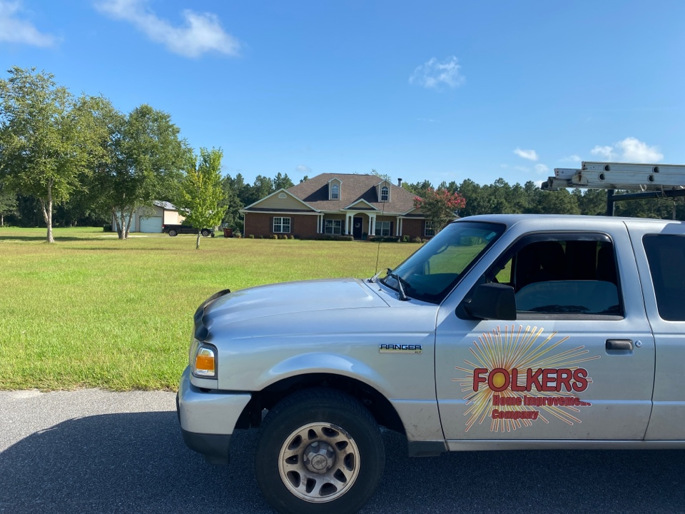 Pace, FL - Measuring for impact replacement shwinco single hung windows and fixed picture windows in Pace Florida