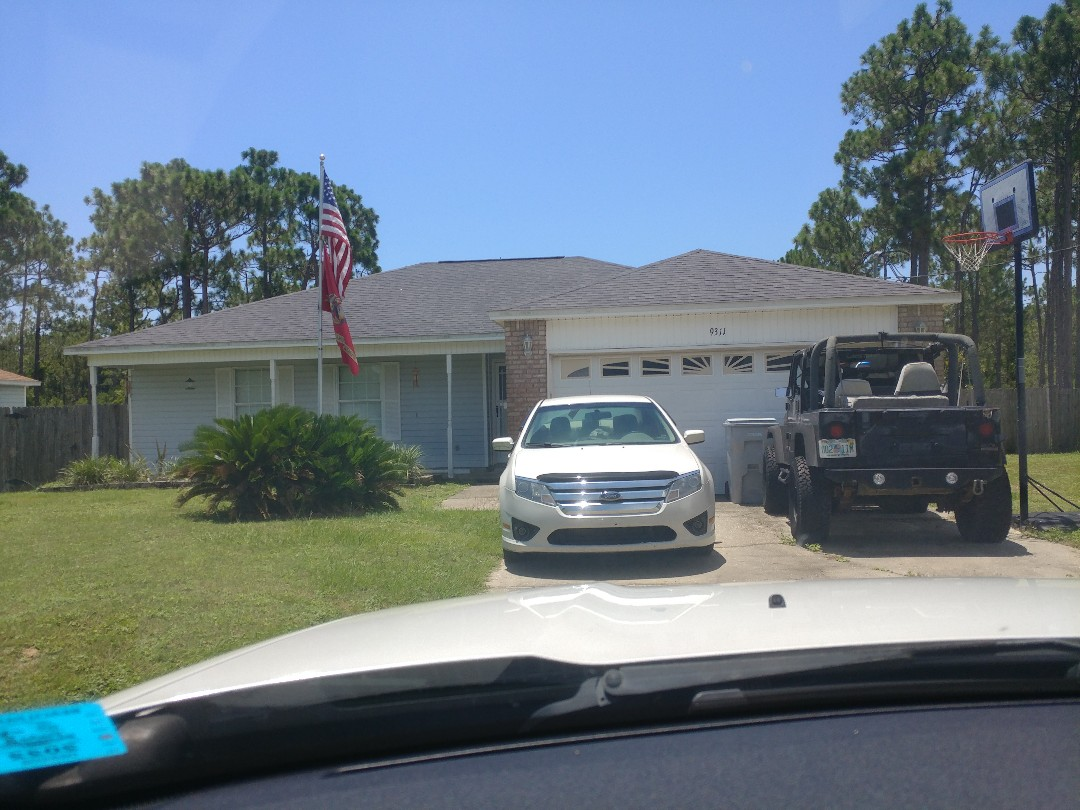 Navarre, FL - Signing up for new windows and sliding glass doors