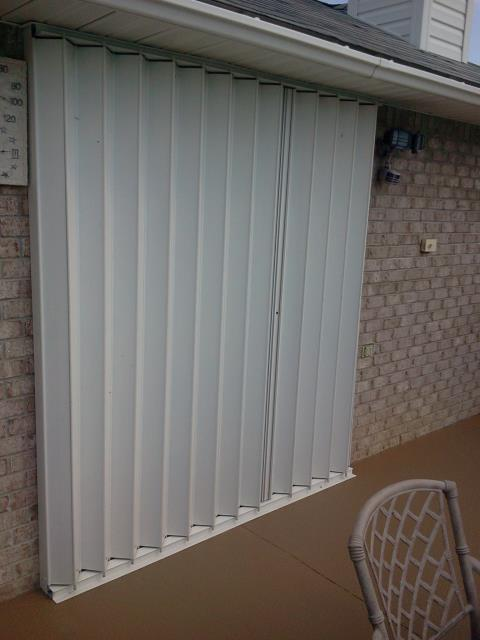 Milton, FL - Measuring for impact folkers accordian hurricane shutters