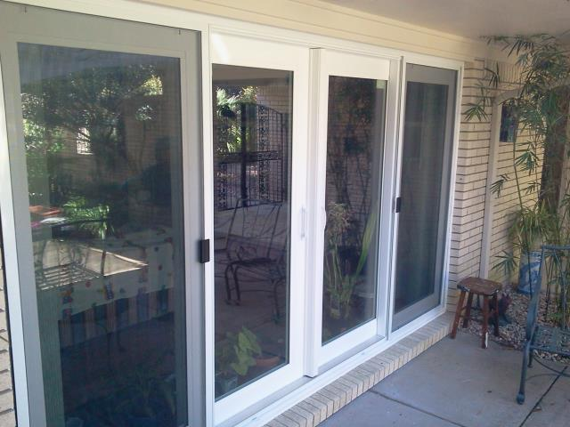 Navarre, FL - Replaced Twenty four custom impact windows with Viwinco and four sliding glass doors with Boise Cascade