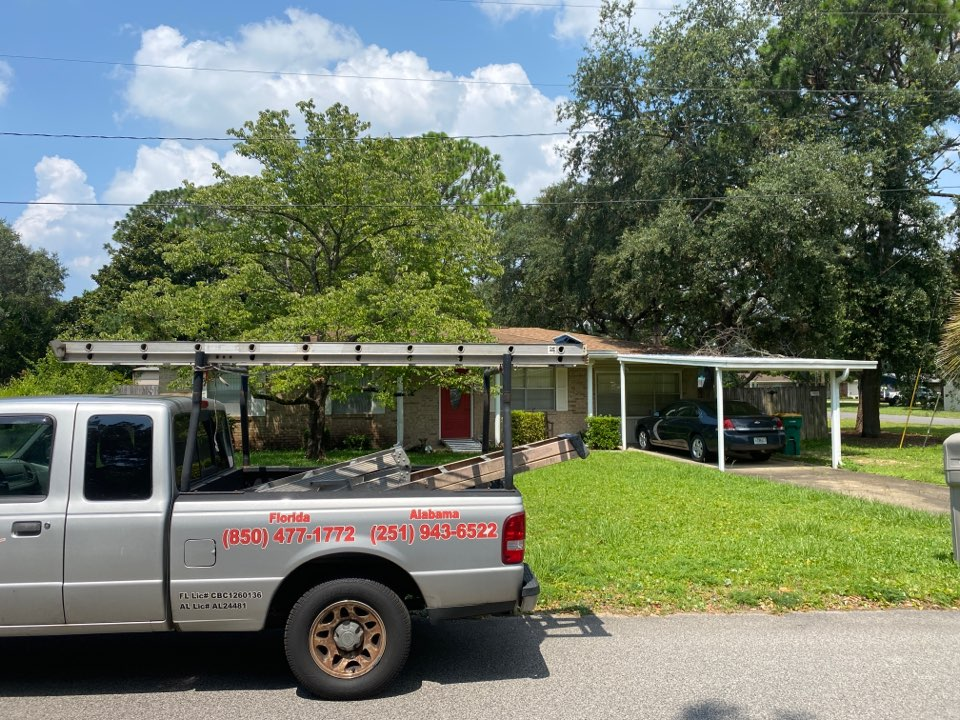 Shalimar, FL - Measuring for impact replacement Viwinco double hung windows and sliding windows in Shalimar Florida