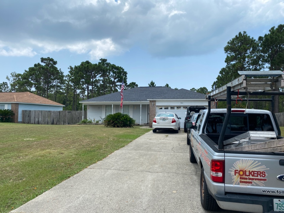 Navarre, FL - Measuring for impact replacement shwinco single hung windows and sliding glass doors in Navarre Florida