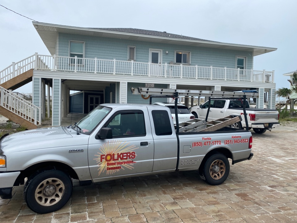 Pensacola Beach, FL - Measuring for impact replacement shwinco sliding glass doors and thermatru replacement entry doors on Pensacola beach Florida