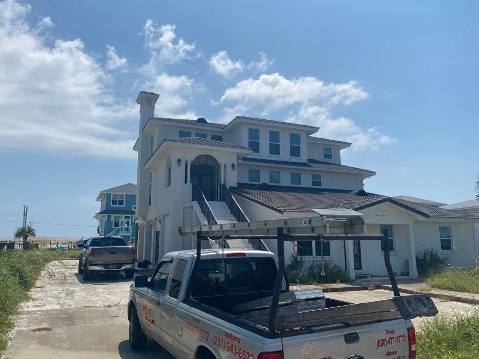 Pensacola Beach, FL - Measuring for impact replacement shwinco swinging doors and impact replacement fixed picture windows on Pensacola beach Florida