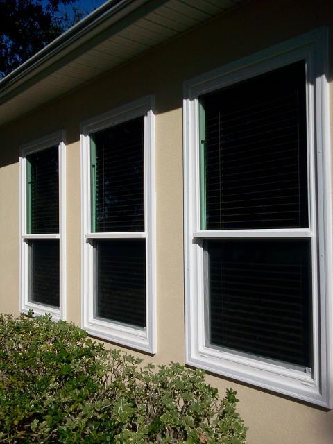 Milton, FL - Measuring for nine impact windows