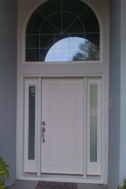 Navarre, FL - Measuring for impact replacement Therma Tru entry door in Navarre beach Florida