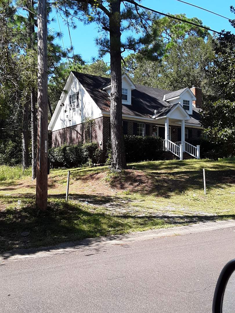 Fairhope, AL - New white vinyl low-e argon single-hung impact rated windows with grids for this customer