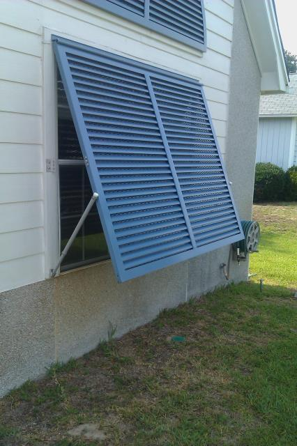 Crestview, FL - Combination of Bahama and Colonial shutters for