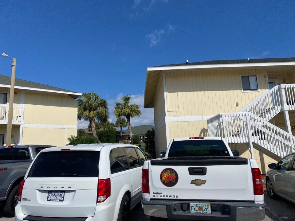 Destin, FL - Measuring for impact replacement shwinco sliding glass doors in Destin Florida