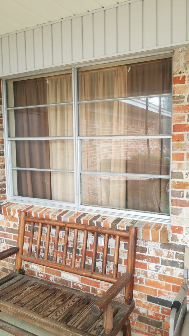 taking out old single pane windows in east Pensacola