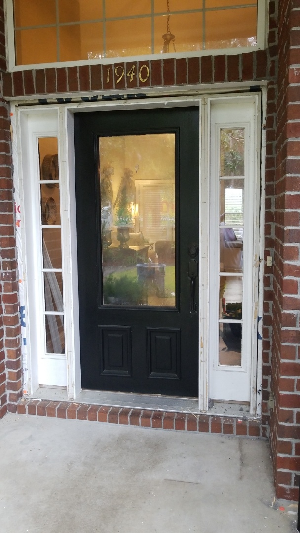 taking out old entry door in west Pensacola