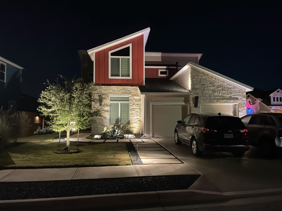 Austin, TX - Amazing looking Easton Park home! Front and back yard elegantly lit using Kichler low voltage LED lighting. System WiFi capable with ease of control from their smart phones.