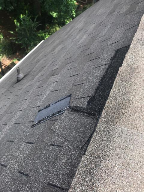 Dunwoody, GA - These slipped shingles are causing this homeowner a lot of issues, firstly they are experiencing internal problems with water entering the property. But they will also be experiencing decking issues, these issues they cannot currently see but in the long term will be problematic! The longer they leave this the more pieces of decking will need to be replaced increasing their cost of replacement. In addition to this leaks also pose problems such as: mold , fire risks and structural damage.