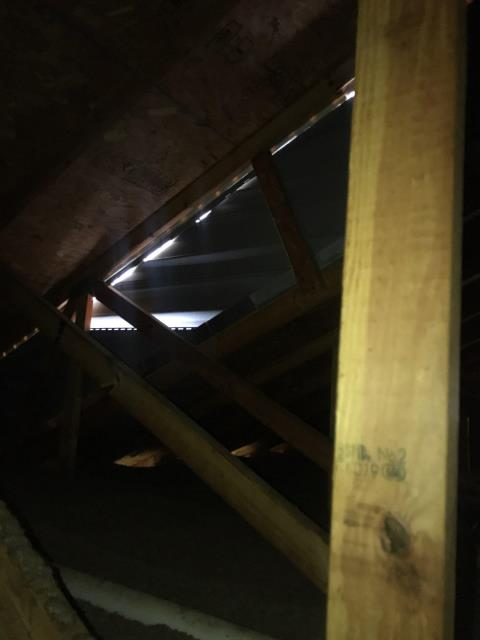 Dallas, GA - Have you been in your attic recently? This homeowner in Marietta GA called us out because they had some water marks on their ceiling. You can see day light in the attic! No wonder they are having problems!