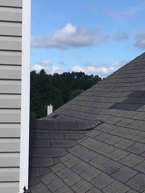 Hiram, GA - This roof has a lot of wind damage and the homeowner is going to file a claim. They have a lot of missing shingles!