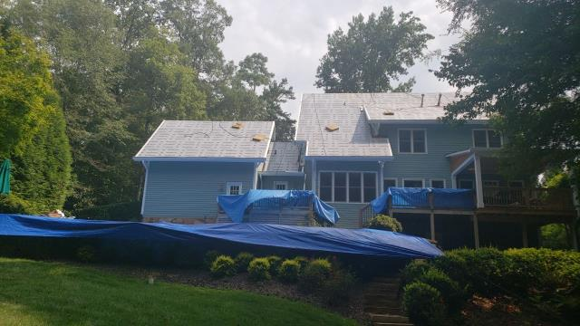 Roswell, GA - Installing this roof today in Roswell, GA, pool is tarped and all the homeowner's bushes protected. We take pride in our work! can't wait to see the finished product!