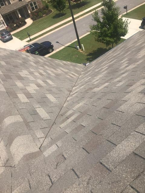 Canton, GA - This roof has been installed incorrectly. The valley you see here is off center! There are lots of other issues too!