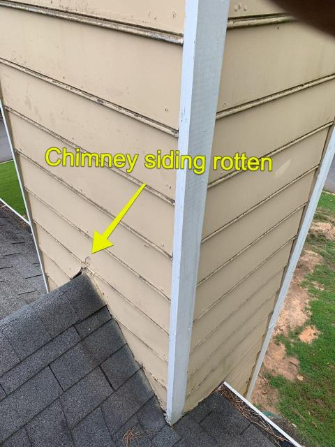 Roswell, GA - There are many reasons you may have a leak and the roof is not always the reason! This homeowner has a lot of rotten wood on their siding of the chimney. Call today so we can help you identify a leak!