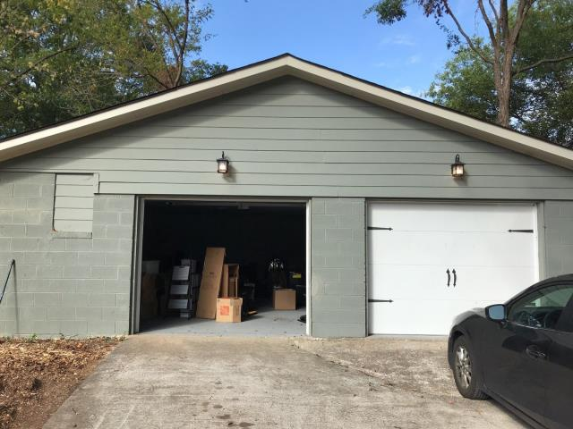 Marietta, GA - This garage has no ventilation and as a result the shingles are cooking from both sides seriously reducing the life span of the shingles. If you need any roofing advice give us a call 678 757 3477