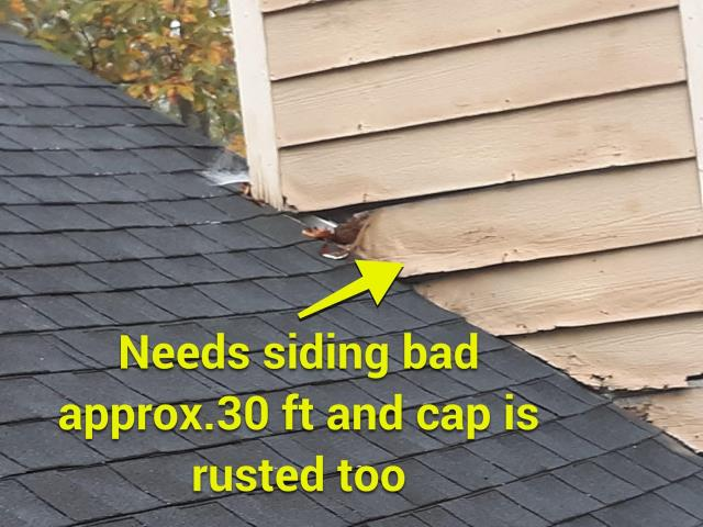 Woodstock, GA - This homeowner had a leak and thought the slipped shingle on the roof was the problem, actually it was the siding. When we do an inspection we look at everything from the top of the chimney to the bottom of the downspouts. We fixed their slipped shingle and recommended a painter for the siding! Leak no more!