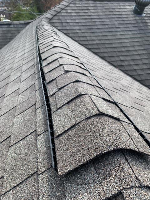 Atlanta, GA - This homeowner has leaks in his roof, the roof is not old but the installation is incorrect. In the roofing industry we call this a Crocodile ridge, the roofers either didn't know what they were doing, or they ran out of ridge cap shingles so thought they would 'make it work' using normal shingles rather than ridge cap shingles.