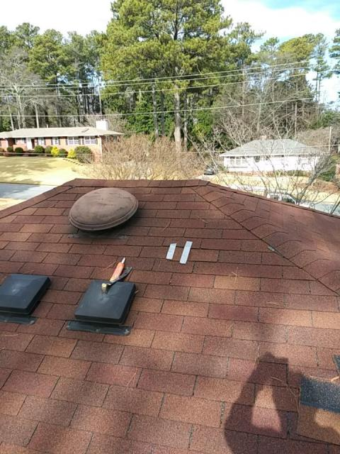 Marietta, GA - This homeowner had a missing shingle. So decided to Duct tape it back on.  