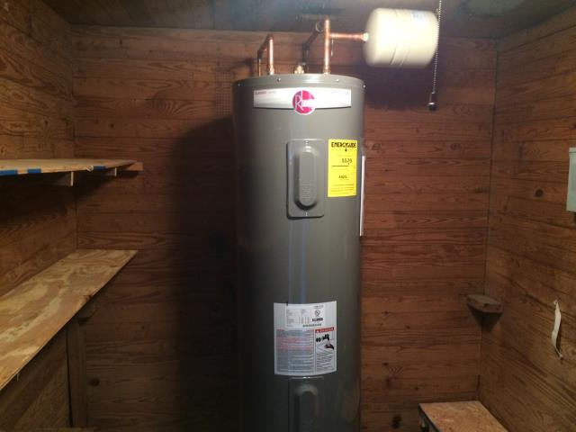 Removed natural gas water heater and furnished and installed 50 Gallon Rheem electric water heater, expansion tank, and ball valve