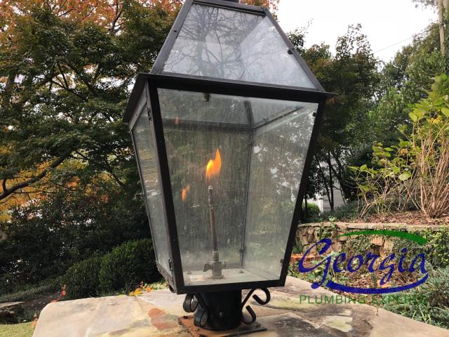 "Repaired 1/2"" polyethylene gas line feeding outdoor gas lights at residence in Atlanta, Ga"