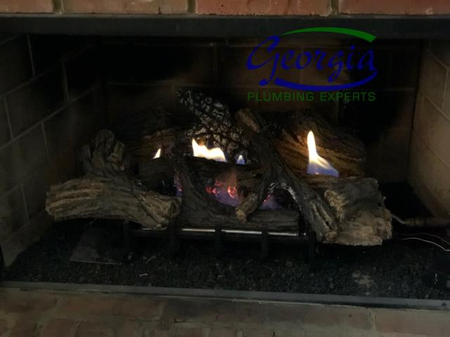 Acworth, GA - Repaired 2 natural gas leaks on gas logs in Home in Acworth, Ga. Lit logs and tested for proper operation