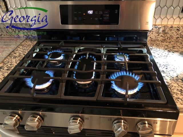 Acworth, GA - Tested natural gas line feeding stove for leaks. Tightened fittings and tested for proper operation