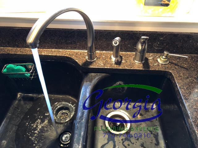Rebuilt Delta kitchen sink faucet with new washers and springs. Installed 2 new cutoff valves under sink in residence in Atlanta, Ga