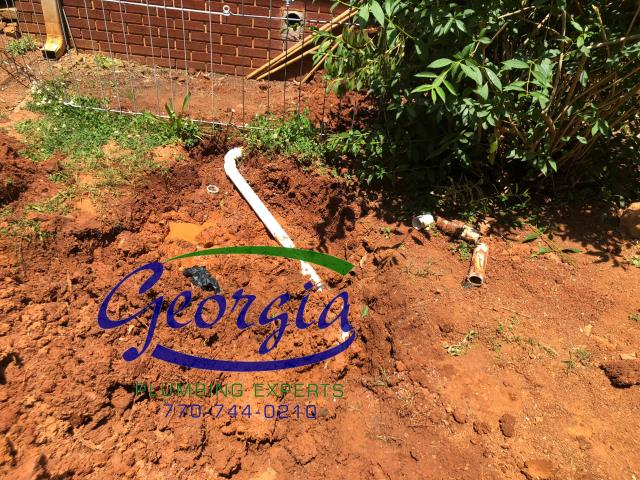 Excavated ground and tied washing machine drain into septic tank main drain line