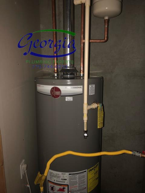 Furnished and installed new Rheem 50 gallon natural gas water heater, ball valve, and expansion tank