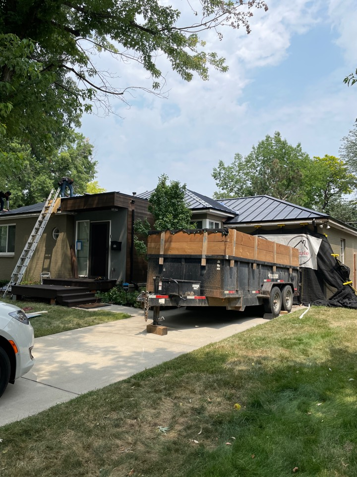 Denver, CO - This project is nearing its end. We have installed EPDM low slope roof system, standing seam metal roof from Sheffield Metals, and repaired the stucco as well.