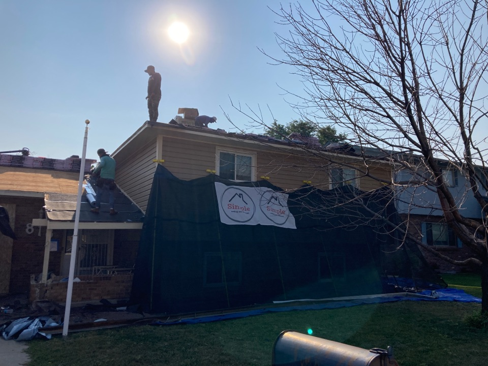 Brighton, CO - Storm restoration day. Replacing roof and gutters due to severe damage from a hail storm. Let us be your local roofer.