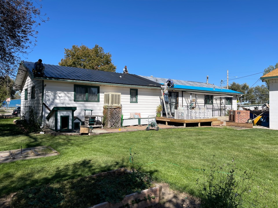Upgrading this shingle roof to a metal roof, impact resistant. We performed a free roof inspection after the hail storm in Wellington, got the roof approved by insurance, and upgraded the roof to metal.