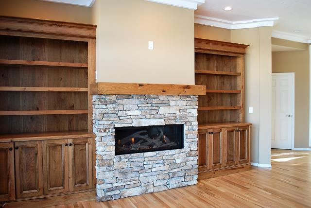 Boise, ID - New fireplace and built in cabinetry in rustic cherry with a glaze.