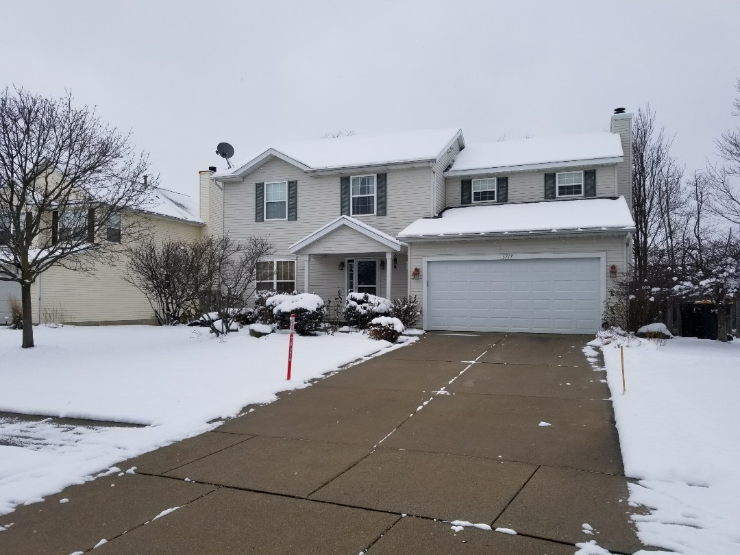 Grandville, MI - Meeting with a homeowner on some missing soffit