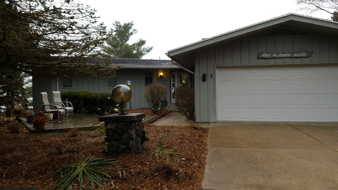 West Olive, MI - Doing a free estimate for a leaky roof at this beautiful lakeshore home