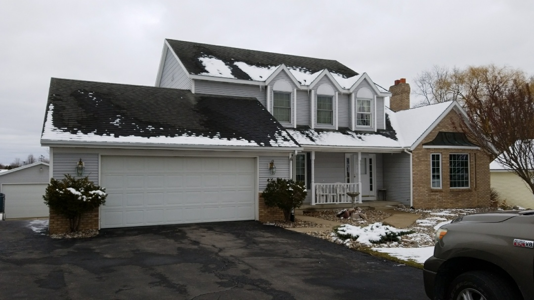 Hudsonville, MI - Getting an estimate prepared for this gorgeous home