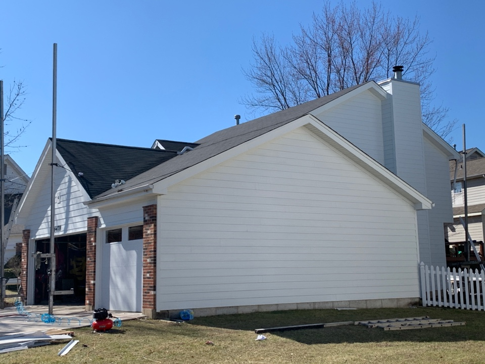 St. Louis, MO - We are installing James Hardie lap siding and trim on the client's house in south St. Louis county.  We also installed new Mastic Ventura hidden vent vinyl soffit and aluminum wrap on fascia wood and the garage doors. The client has been very happy with progress the first few days of this new siding project.