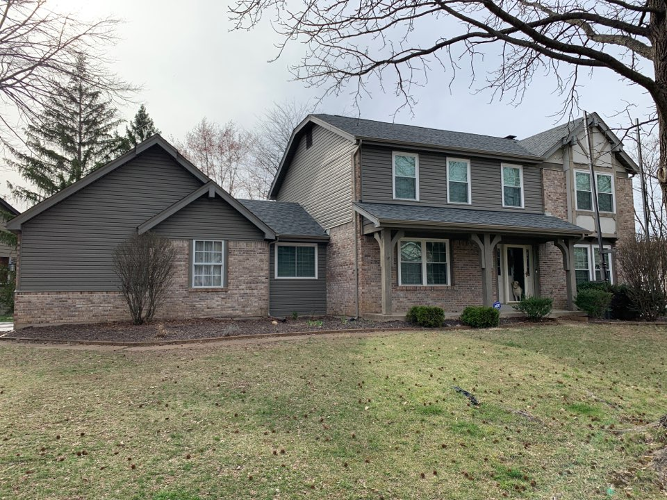 Chesterfield, MO - We are installing new vinyl siding on the front of this house in Chesterfield, MO to replace the stucco & wood trim look at the far right. The vinyl siding is Mastic Quest, color = woodland green.  The client is very happy with the new look.