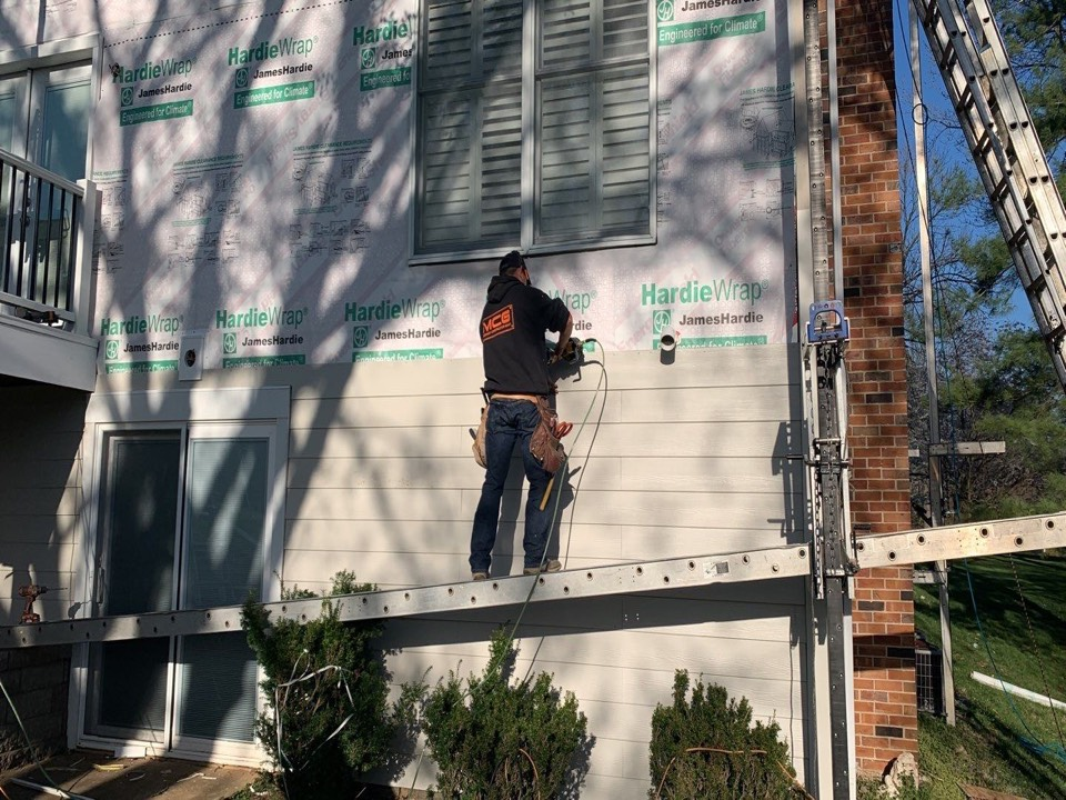 St. Louis, MO - We are installing new James Hardie finer cement lap siding on this house in Town & Country, MO. The client chose color = cobblestone and is very happy with the new look.