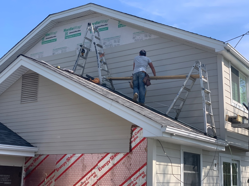 St. Louis, MO - We continue work on this new James Hardie fiber cement siding project in Town & Country, MO   The upper gable is James Hardie lap siding with trim, color= cobblestone. The lower gable is the old  triple panel wood siding.